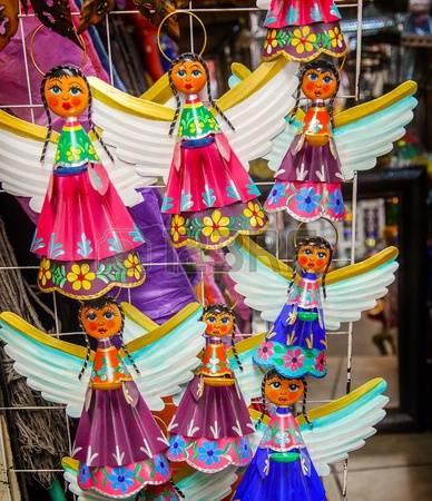 61901381-colorful-mexican-angel-souvenirs-christmas-decorations-san-miguel-de-allende-mexico